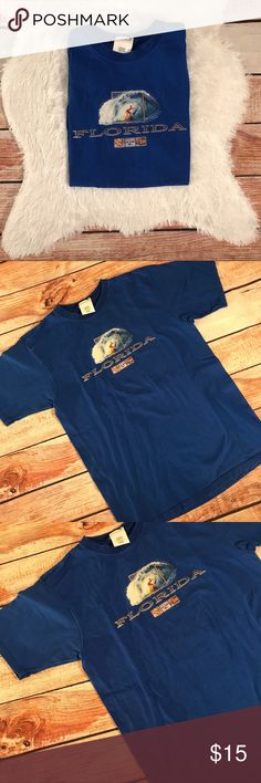 v i n t a g e | bright blue florida souvenir tee Super bright blue  vintage FLORIDA travel vacation tourist souvenir t-shirt. Size medium, true to size. Excellent  condition. Perfect, no flaws or defects. Extremely bright. Fabric is still crisp. Like new.   ALL ITEMS ARE CLEANED & COME FROM A COMPLETELY SMOKE FREE HOME! #smokefree  #sale #deal #clearance #gift #present #vintage #vtg #retro #freeship  #bright  #blue  #likenew  #florida  #vacation #tourist  #travel   #souvenir Vintage Shirts…