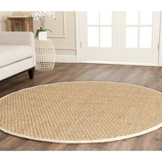 Safavieh's Natural Fiber collection is inspired by timeless contemporary designs crafted with the softest seagrass available. This rug is crafted using a power-loomed construction with a virtually non-shedding seagrass pile.