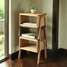 Tokotoko - it can serve as a side (or bedside) table, as a stool, or it can even be stacked to create a modular shelving unit