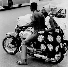 A man and a lady on a motorcycle in Lagos Nigeria (1969) Vintage Nigeria