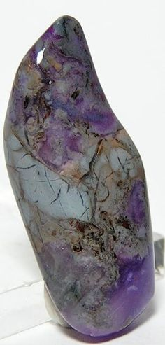 Purple Sugilite - a good pain reliever, the manganese in Sugilite clears headaches & discomfort on all levels.  It treats epilepsy & motor disturbances & brings the nerves & brain into alignment.  Light coloured Sugilite purifies lymph & blood.