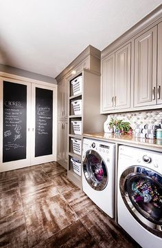 One of the best laid out laundry rooms I have seen! Love the chalkboard doors and shelves with baskets for laundry