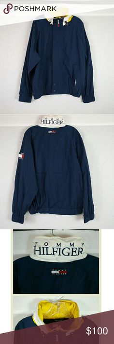 """Vtg Mens 90's Tommy Hilfiger Windbreaker Jacket From the 90's, hood is still attached in back neckline compartment. Armpit to armpit: 25"""" & length 26"""". PLEASE READ: overall condition is great but the right back shoulder has a few small white streaks not very noticeable but I wanted to make mention of it. Add to a bundle to receive 20% off 3 or more items. Offers welcomed. e5. Tommy Hilfiger Jackets & Coats Windbreakers"""