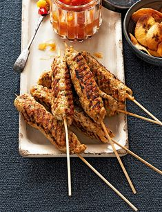Spiced chicken skewers with mango and red pepper jam. In Zanzibar, enterprising street-food sellers convert their bicycles into barbecues with pedals. Most of the delicacies come on a skewer, such as this spicy chicken. These make great party food to pass round hot from the oven.