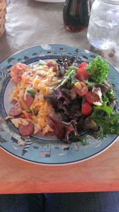 Carolina scramble, add cheddar cheese, spring mix salad. Three Little Birds Cafe, Charleston, SC. 9*