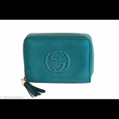 """Gucci Soho Nubuck Mini Zip Around Wallet Style: 351484 AHH2G 4618.                           Teal nubuck leather with teal leather detail Made in Italy Embossed interlocking G Leather tassel Zip around closure Four card slots and two small compartments Zip coin pocket.                            Measurements: 5"""" L x 3.75 W x 1"""" D.         Includes Gucci box and Controllato card. Gucci Bags Wallets"""