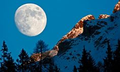 An almost full moon rises behind the Tijerflue mountain in Arosa, Switzerland. Photograph: Alessandro Della Bella/EPA