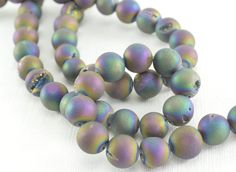Druzy Agate Geode Round Beads Half Strand, 7 1/2 inches 12mm, 16 loose beads Teal Peacock Druzy Titanium Coated Metallic Druzy Agate KJ by SweetCarolineGems on Etsy