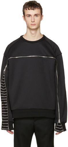 Long sleeve jersey pullover in black. Oversized fit. Rib knit crewneck collar. Zippered extension panel revealing trim striped in black and white at front and sleeves. Panelling at shoulders. Tonal stitching.