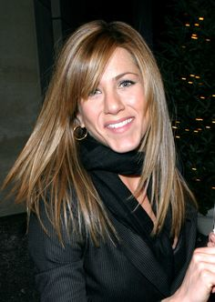 In early 2004, Jen got sleek side bangs to go with her long, straight hair.  - GoodHousekeeping.com