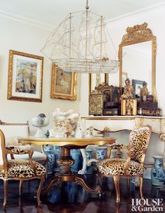 Chairs in a vintage leopard velvet provide bold contrast to a delicate boat-shaped chandelier. #houseandgarden