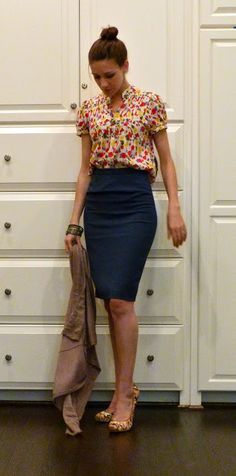 I like the contrast between the bright and busy top and the subdued basic pencil skirt.  I frequently dress like this.