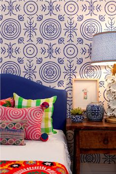 Anna Spiro's new wallpaper range in collaboration with Porters Paints is divine! This royal blue colour looks amazing with the colourful cushions on the bed. See more of her range here: http://www.adoremagazine.com/blog/2012/5/25/anna-spiros-new-wallpaper-collection.html