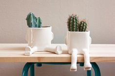 This pack contains 2 pots: 1 Sitting and 1 Sprawl  20% off the highest priced item!    Ceramic pots modeled and decorated by hand.    **Unique