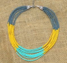 Mint, grey, yellow short multi strand patterned seed bead necklace. 16 inches adjustable.