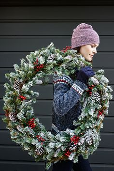 Make the holidays feel at home with Pier 1's Snowy Pine Wreath. This traditional wreath of faux pine branches and natural pinecones is pre-lit and lightly flocked to grace your mantel, doorway or wreath hanger in the luxury of light. That, and it's handcrafted, so no one else will have one quite like yours.
