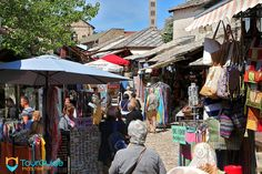 Tourists enjoying sightseeing in the Old Town of #Mostar.  #tourguidemostar #sunday #shopping #travel #ottoman #turkish #market #explore #tourism #bazaar
