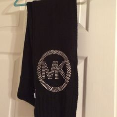 Authentic Michael Kors scarf Authentic MK winter scarf with blinged logo. In excellent condition, worn a few times, but no snags, damage or odors. Don't ask to trade or for a deal, I'm not interested. Michael Kors Accessories Scarves & Wraps