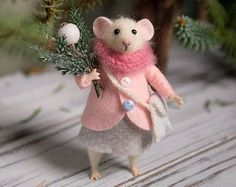 This little mouse was hand made by wool using needle felted techniques. It holds standing alone just have to adjust the foot and tail. The hands and the legs can be moved in different positions, also the head can be turned in both directions. It comes with a yellow coat, gray skirt, white scarf and small gift box. Tiny gift for you or a friend of yours, nice collectables woolen animal. Great present for everyone who admires handmade Eco-friendly creations.  Size is about 10 cm or 3.9 inches…