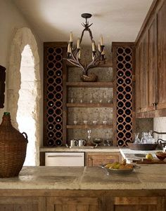 Described the countertops as being zinc, though these look like big, rustic tiles.  Love the wine storage too.