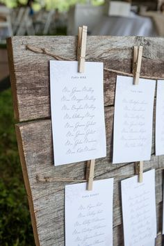 Barnwood and clothes pins make perfect rustic wedding accents! I would use a dark wood, and the table lists would be on burlap.