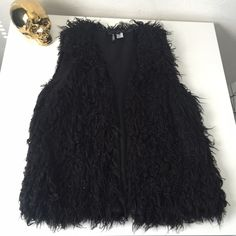 H&M shaggy faux fur vest in black This H&M shaggy furry black vest is right in trend! Never worn. Purchased new by me in store. Size is 14 but fits a M/L perfectly. As always, comes from a smoke free home. H&M Jackets & Coats Vests