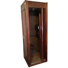 """This 1940s Western Electric phone booth has been remarkably preserved, complete with hammered tin walls, original phone, exterior metal light fixture and seat. With working lights and a phone that merely needs a new wire to work on modern lines, you are one step away from winning every """"but my phone's more impressive"""" argument."""