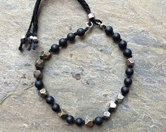 Subtle, matte onyx and pyrite stone bracelet, carefully hand knotted with black thread. Thread Bracelets, Black Thread, Stone Bracelet, Beaded Necklace, Trending Outfits, Unique Jewelry, Crystals, My Love, Etsy