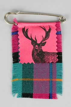 to sew some fabric onto kilt pins for kids to embroider?  headbands rather than pins... tartan ribbon/buttons scottish squares/bells