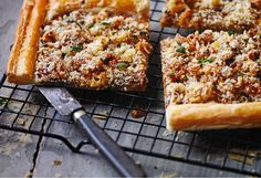 Top puff pastry with tangy mustard, onions and Parmesan cheese for a light vegetarian lunch or party buffet nibble.