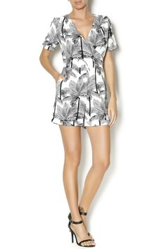 Short sleeve romper with a white and black palm tree print