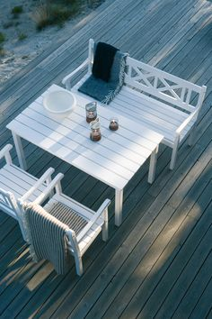 Outdoor table set with bench seating.