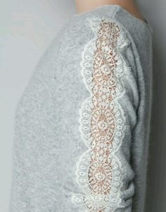 Cut out a section of a long sleeved shirt and sew lace in its place.