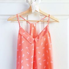 ✨HP✨ Coral Pony Print Tank Super sweet light coral pony print tank (racerback style). Slighty sheer, lightweight. Worn once with no imperfections. This top runs a little large - fits more like a M/L. ✨Host Pick | Style Obsessions | 072416✨ Francesca's Collections Tops Tank Tops