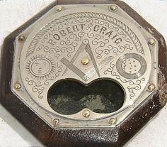 19th century Masonic snuff box. Hand engraved with the Square and compasses, the Sun and the Moon, a handshake and its owner robert Craig. The bottom (6 o'clock stud rotates exposing a double circular opening for the fingers (to get the snufff)