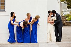sneaky bridesmaids OR bridesmaids and bride getting a peek at the groom :)