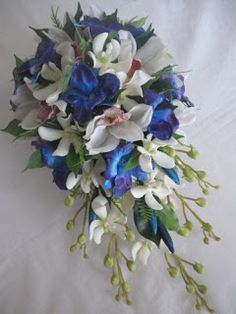 lovely cascading bouquet of blue dendrobium orchids, real touch cymbidium and vanda orchids, buds and greenery.