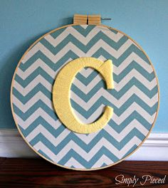 Yarn wrapped Letter on fabric in embroidery hoop