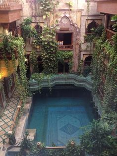 If ever I had a large estate or mansion, I would love a courtyard pool like this! It's magical and comfort all in one! <3