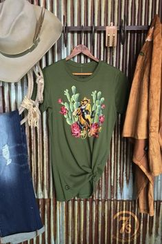"""The Buckaroo {olive} - """"Buckaroo"""" cactus graphicfittedtee. Colorful cowboy and damsel in distress, cacti, floral and horse graphic. Olive fitted tee. Original graphic design by Rodeo Quincy. Soft slim fit. Fitted style, runs a size and a half small, small fits size 0/2, medium 3/4 etc."""