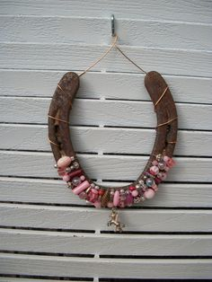 My mom made me two of these, one with turquoise stones and one with blue stones, with shoes my horse had used. I love them.