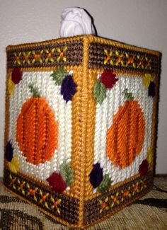 This tissue box cover brings the colors of fall into your home. Each side features a beautiful pumpkin and fall leaves. The box is hand stitched to fit any standard boutique sized tissue box cover. It is a great addition to your Halloween or Thanksgiving decorations yet simple enough to use all fall long
