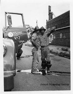"Windsor firemen who are standing beside the open door of Windsor Fire Department Engine No. 7. The engine is parked in the street and a small hose can be seen in the center area of the image. A bowling alley and Standard Oil gas station are visible in the background. Handwriting on the verso shows ""picture of Windsor Fire Dept., Detroit riot, July 1967."" Fire Department, Fire Dept, Detroit Riots, Gas Station, Firefighter Pictures, Detroit History, Windsor Ontario, Standard Oil, Fire Equipment"