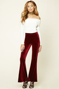 A pair of velvet pants featuring flared bottom and an elasticized waist.