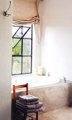 metal window with modern pour cement tub