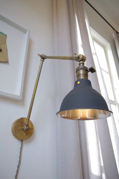 Articulating Industrial Wall Lamp - O.C. White Style Scissor Lamp - Steampunk Lamp Light - Brass Lamp with Gas Station Style Shade. $225.00, via Etsy.