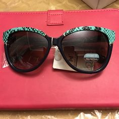 Sunglasses Sunglasses. Brand new. Includes carrying pouch that doubles as a micro fiber soft cleaner for the lens. (329) Accessories Sunglasses