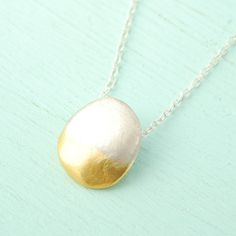 I LOVE the mix of silver and gold.  What better than an ombre pebble necklace? Ombré jewelry trend.  PEBBLE OMBRE Organic shaped pebble pendant necklace - handmade eco friendly sterling silver dipped in 24kt gold.  handcrafted by Chocolate and Steel