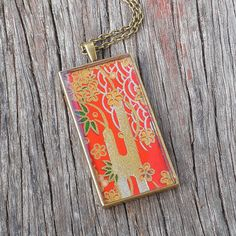 Japanese Red and Gold Chiyogami Resin Antique Brass Pendant Necklace $28