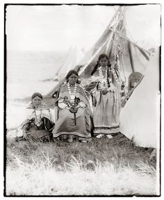 Apache Indian Maidens posing by their teepee. Photo taken by William Pennington in early 1900s.